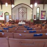 Photo of church pews before the altar